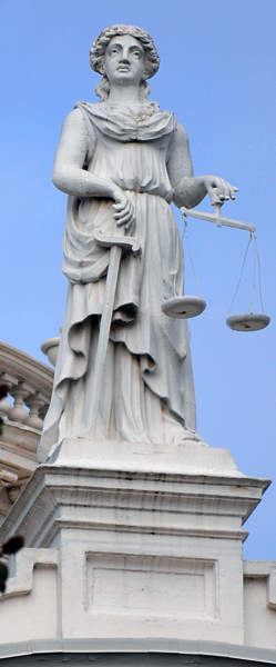 Statue of Roman Goddess Justica or Lady Justice atop the old Merced County Courthouse in Merced California. Photo by Charles Guest of memorable Places Photography